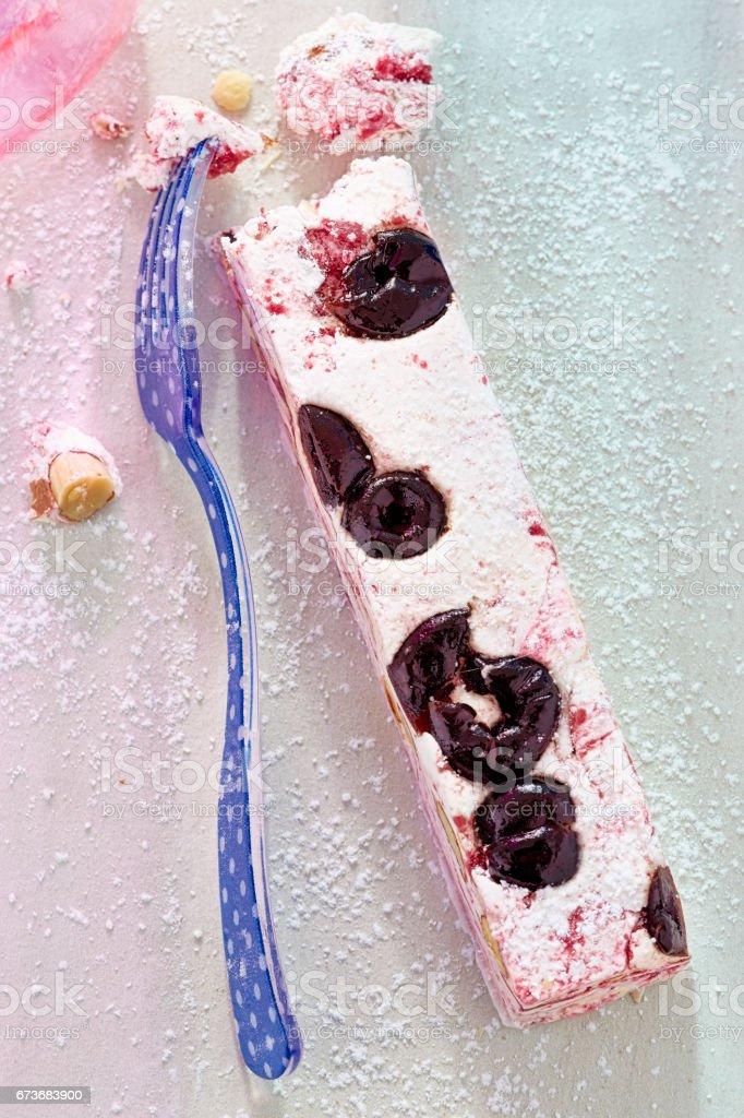 White nougat with sour cherries stock photo