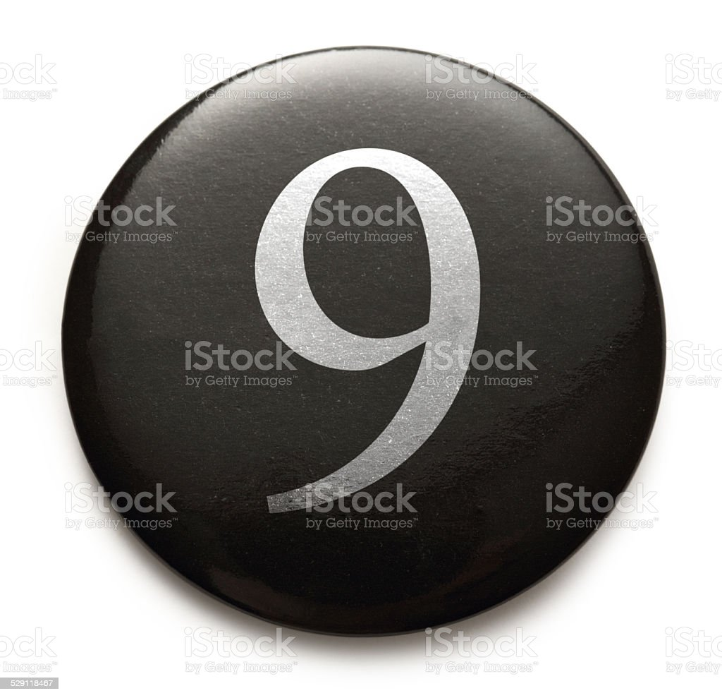 White number 9 on black badge stock photo