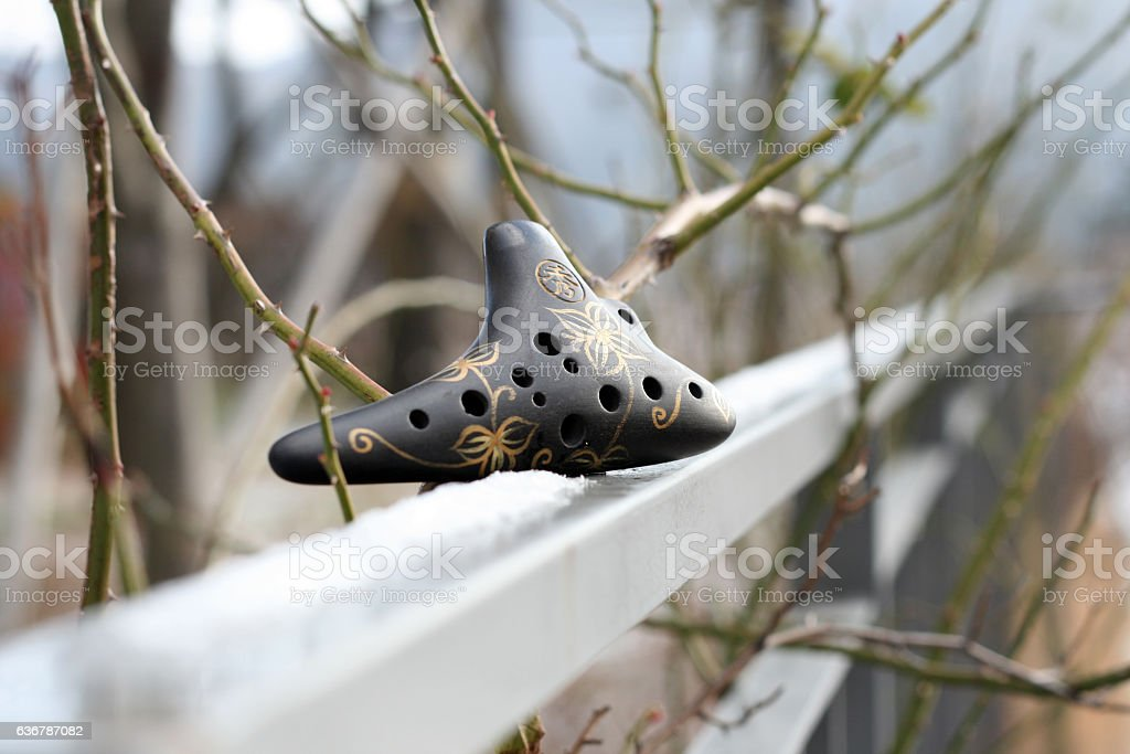 white ocarina stock photo