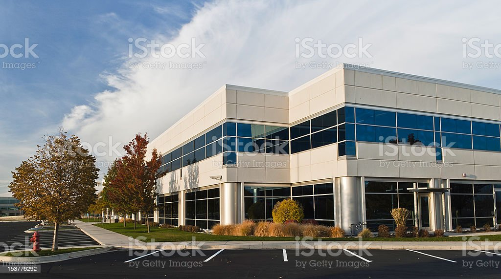 White Office Building at Dusk stock photo