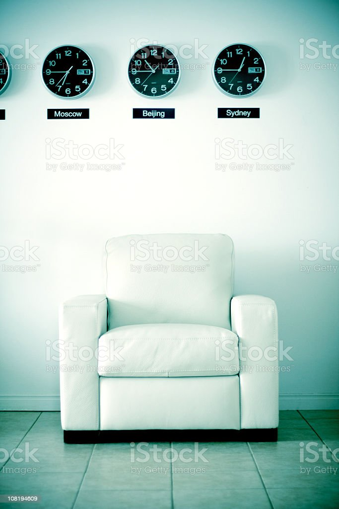 White Office Chair Below World Time Clocks royalty-free stock photo