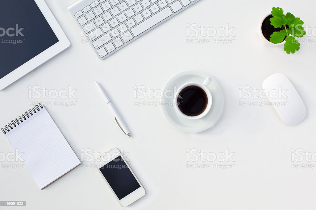 White Office Desk Table Electronic Gadgets Stationery Coffee Cup Flower stock photo