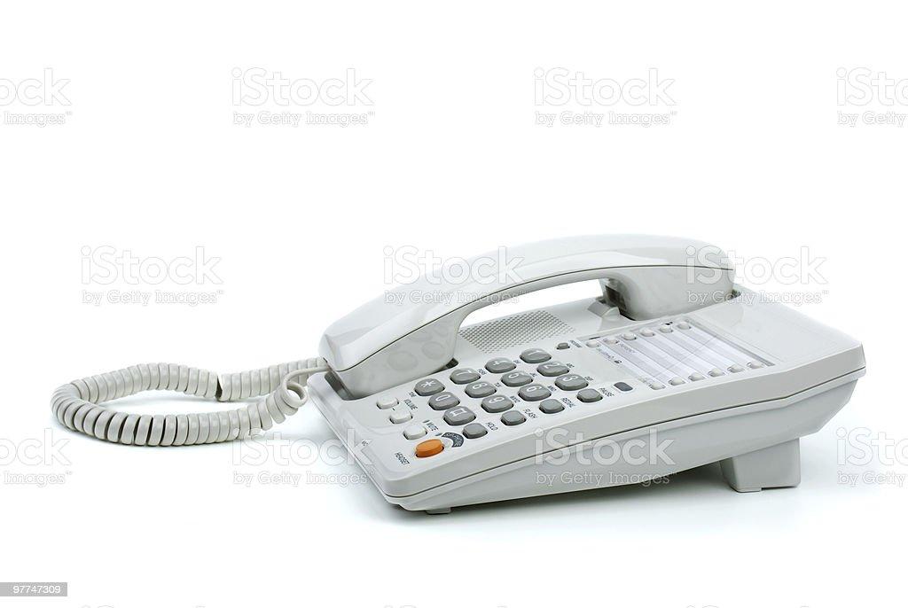 Branco telefone do escritório com telefone no descanso foto de stock royalty-free
