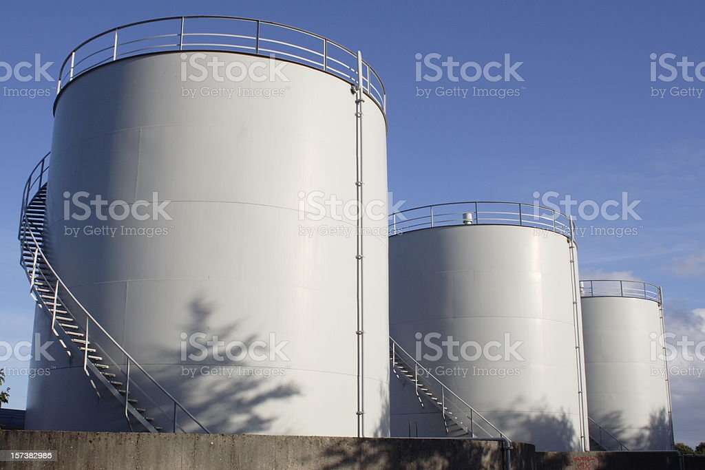 White oil tanks for storing fuel appear to be blank canvases stock photo