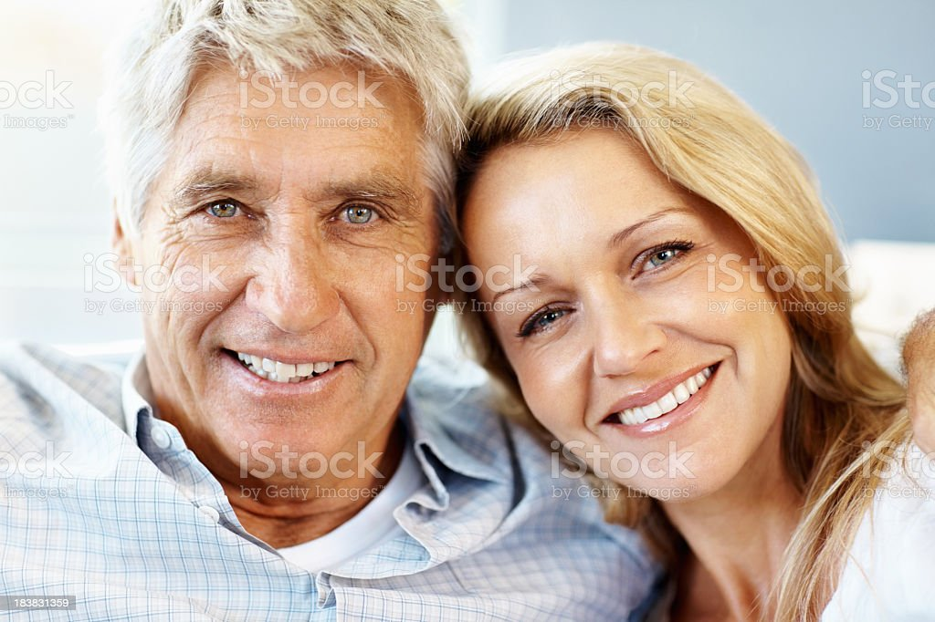 White old woman and man side hugging stock photo