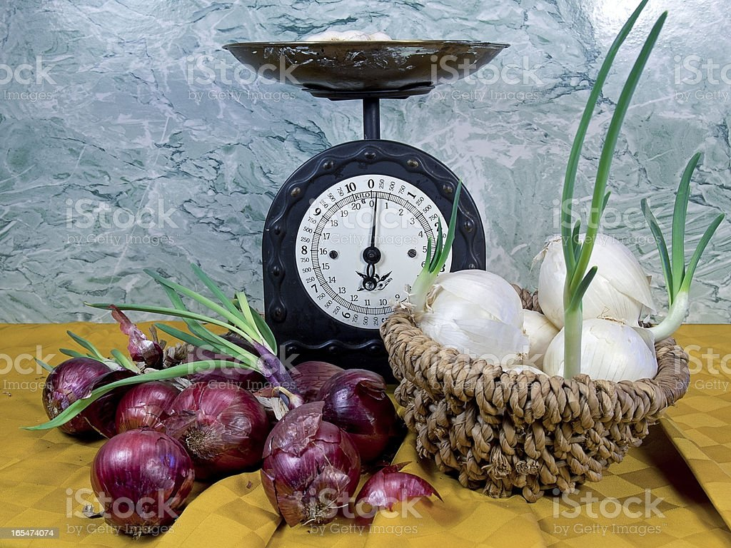 white onions and red near an old scale royalty-free stock photo