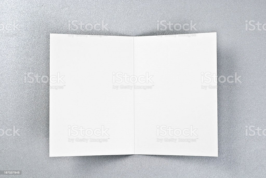 White open card over silver background stock photo