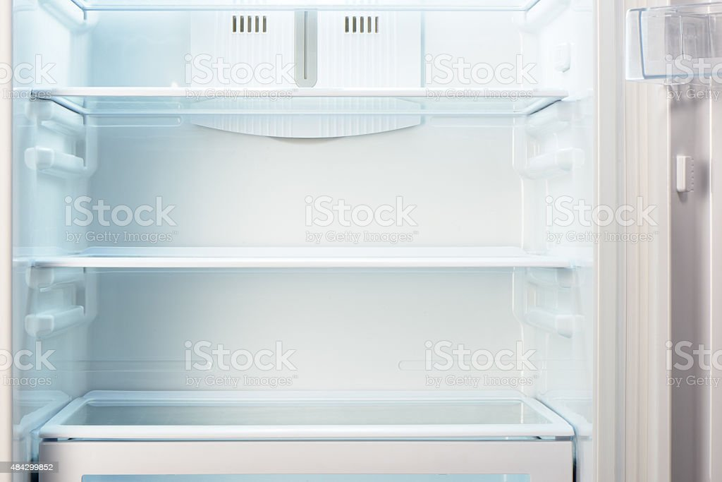 White open empty refrigerator. Weight loss diet concept. stock photo