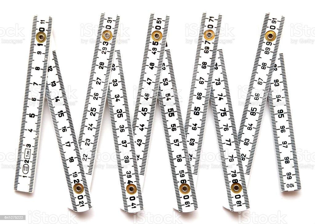 White open one meter folding ruler stock photo
