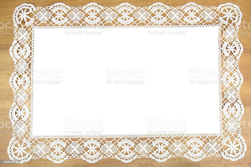 White openwork lace  on wooden background stock photo