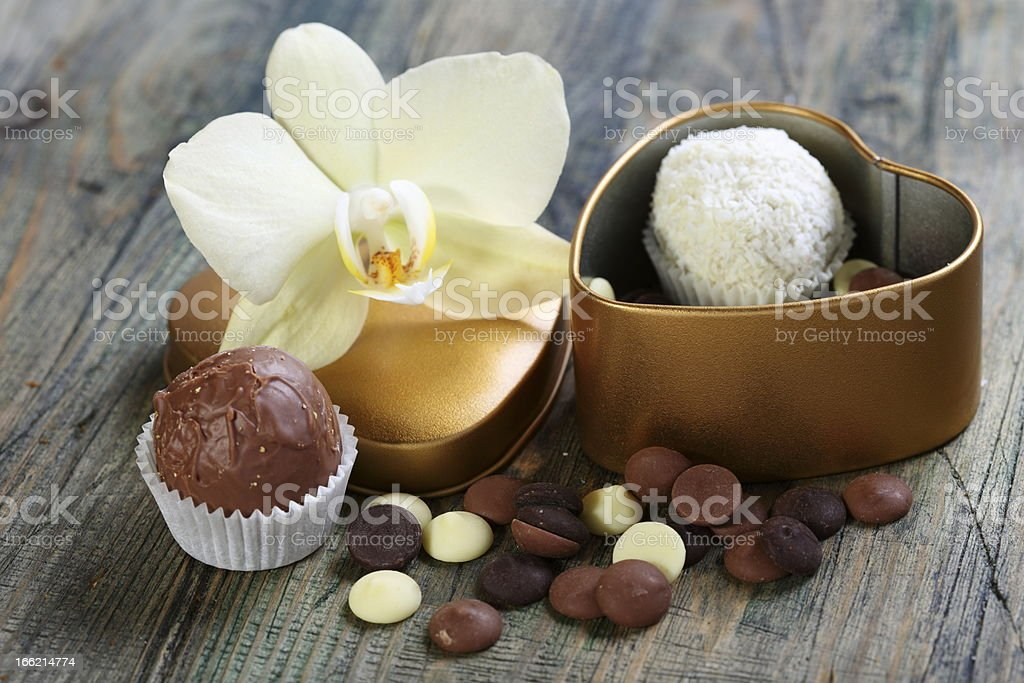 White Orchid and handmade chocolates. royalty-free stock photo