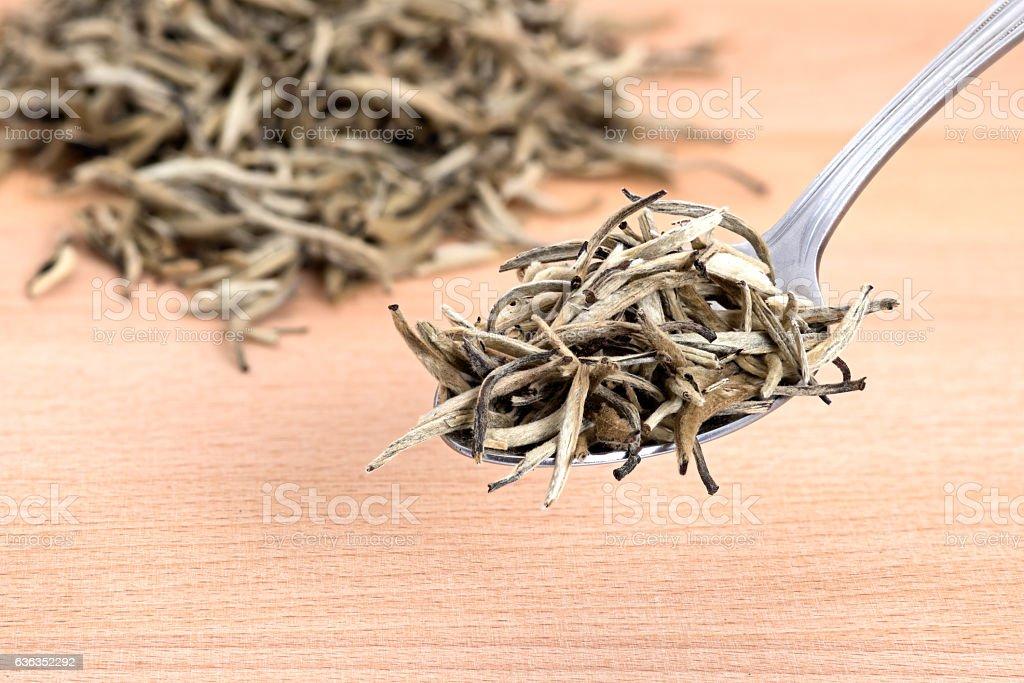 White Organic Needle Tea  on Cutting Board stock photo
