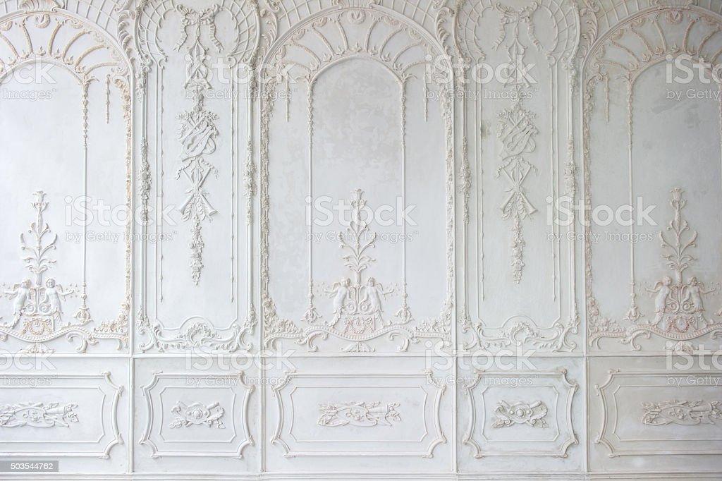 White ornate plaster wall pattern stock photo