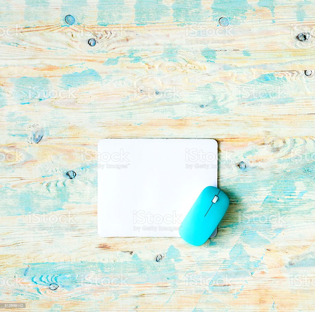 white pad with blue mouse stock photo