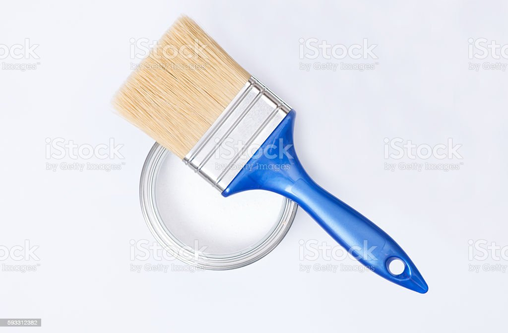 White paint can with brush stock photo