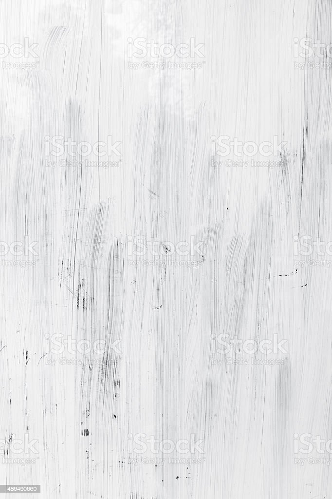 White paint layer over glass wall, vertical background stock photo