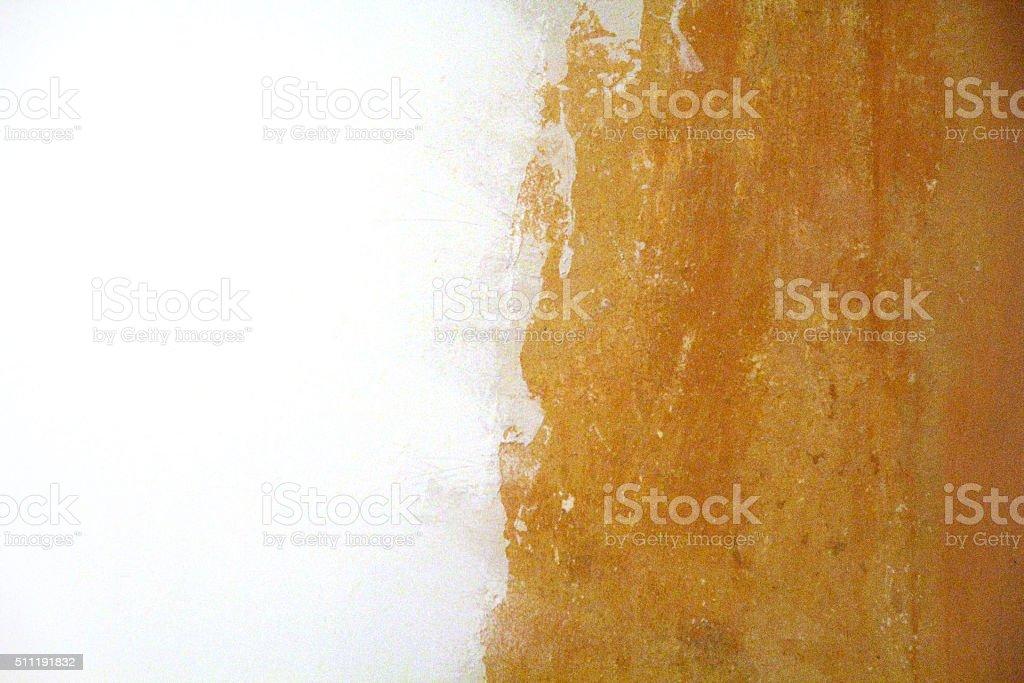 White paint on orange wall texture stock photo
