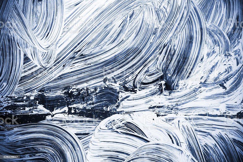 White paint over dark blue glass stock photo