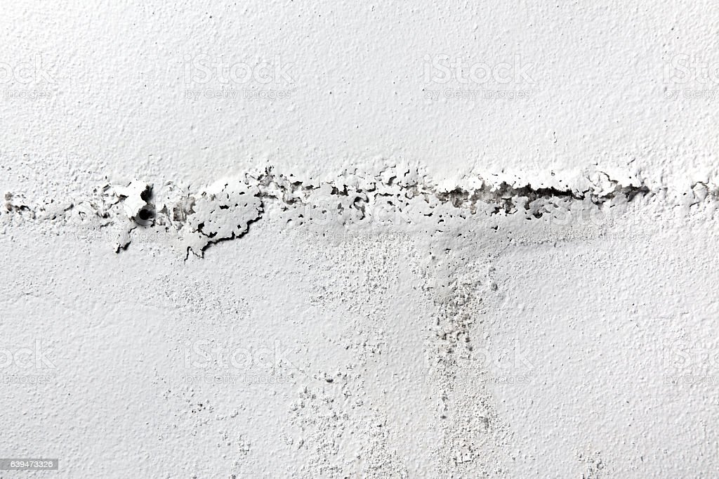 White painted damp wall background stock photo