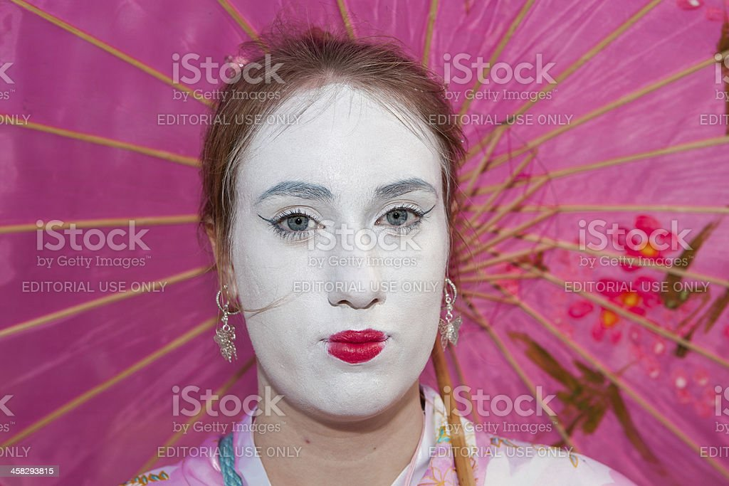 White painted lady with pink umbrella at Fantasy Fair royalty-free stock photo