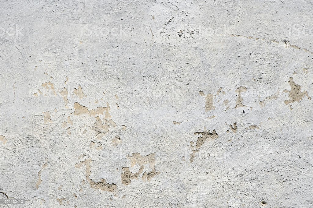 White painted old dirty wall with defects royalty-free stock photo