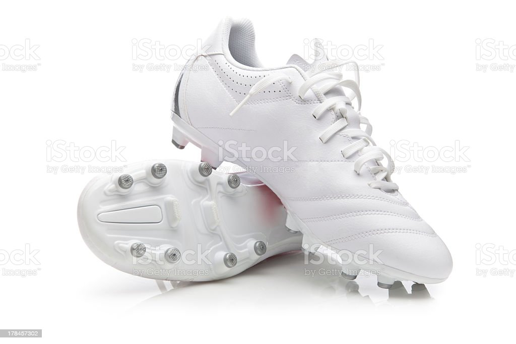 White pair of soccer shoes in white background stock photo