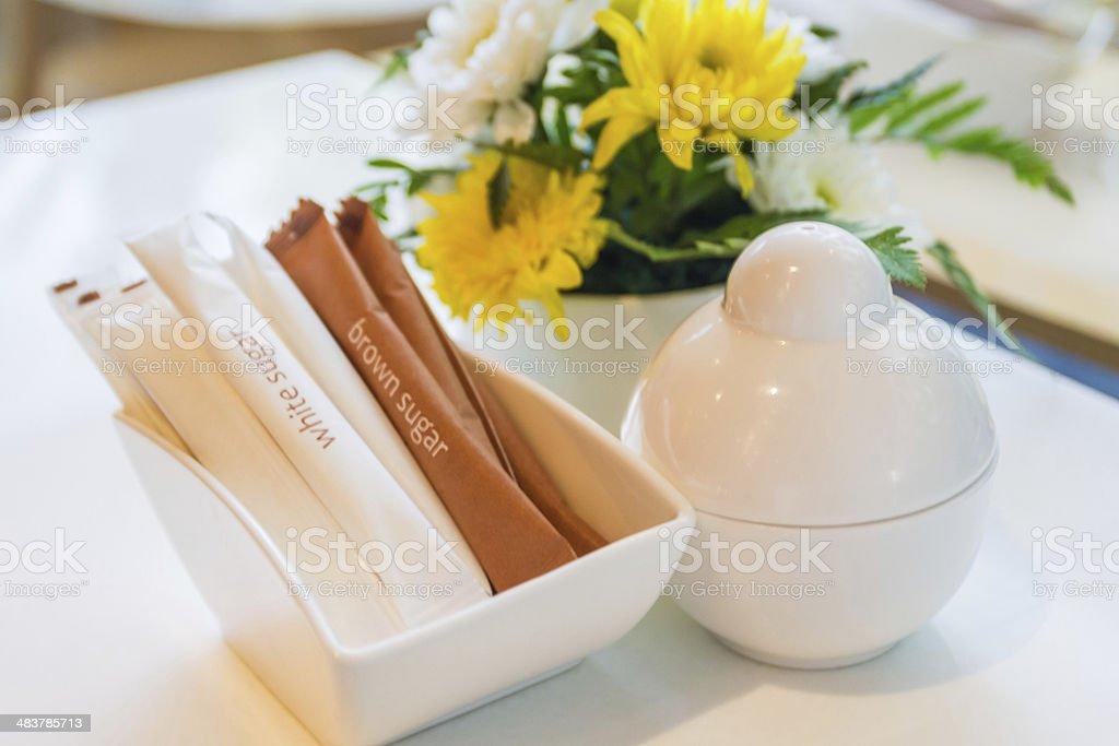 White paper bag sachet  for white and brown sugar. stock photo