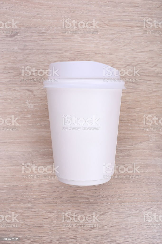 White paper coffee cup on wooden background stock photo