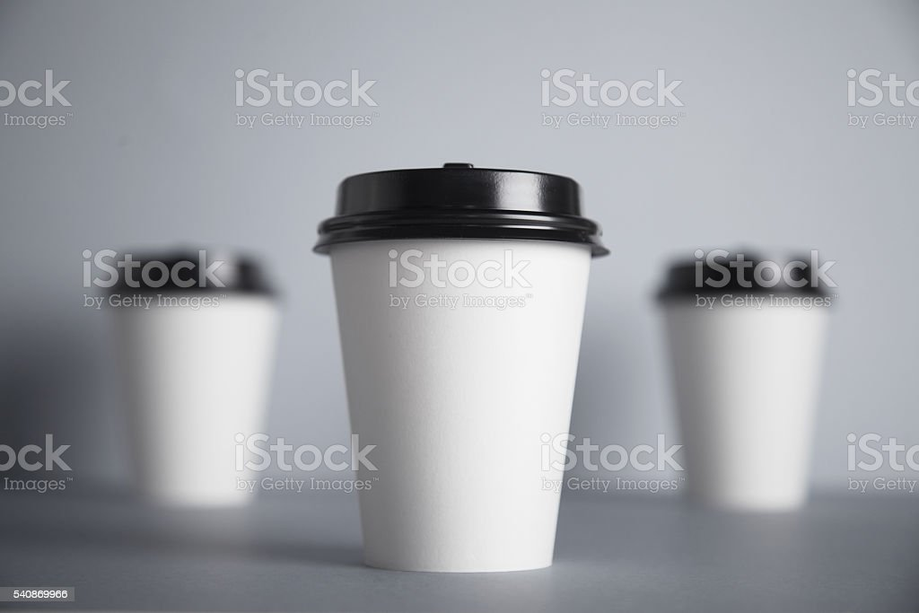White paper cups isolated on gray mockup set stock photo