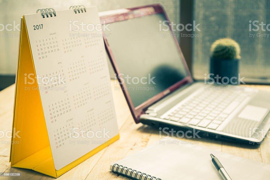 White paper desk spiral calendar 2017 on wood desk. stock photo