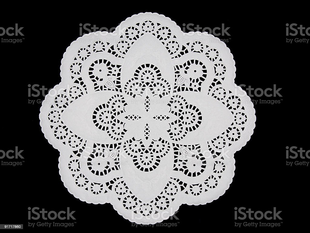 White paper doily on black royalty-free stock photo