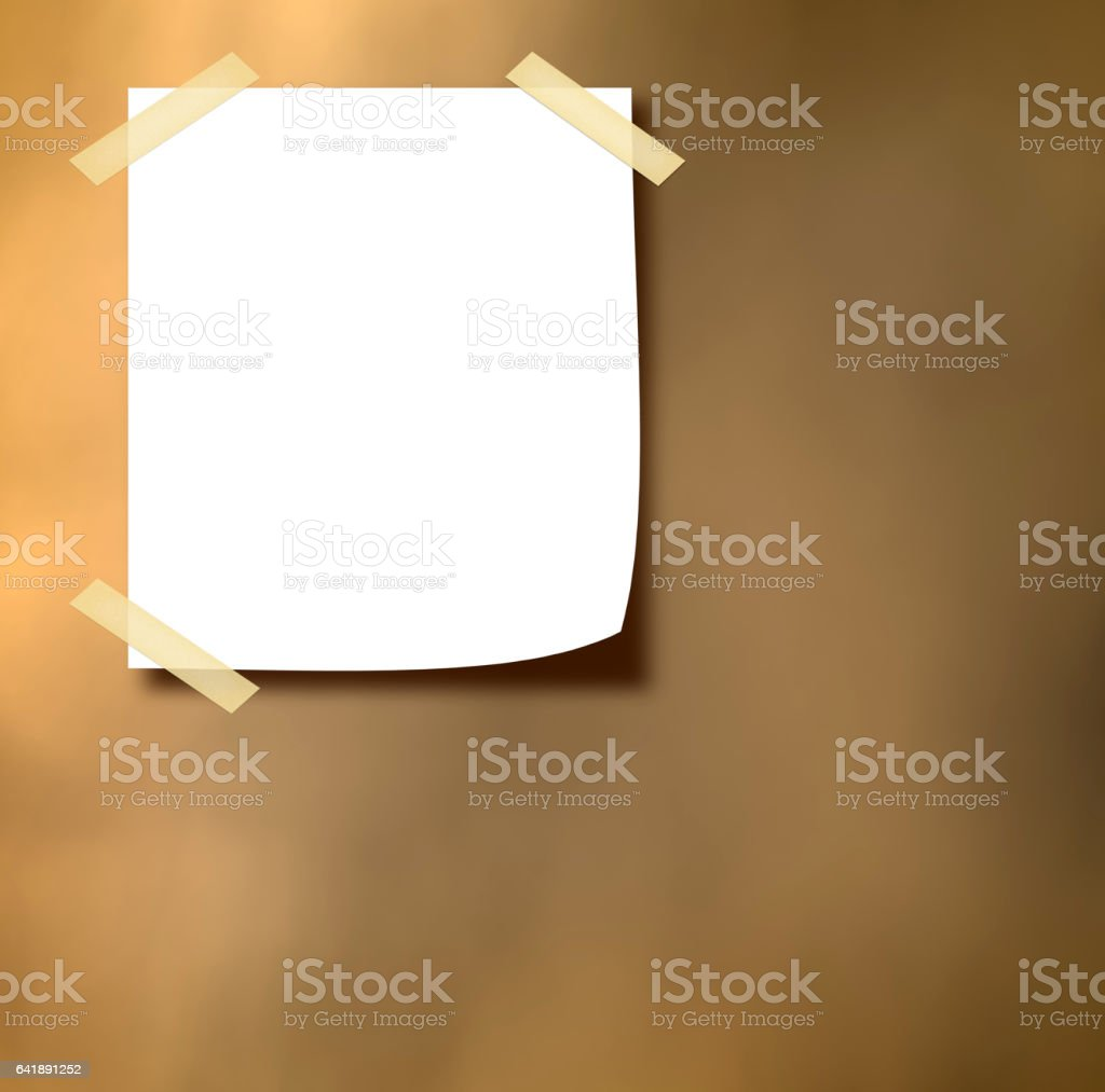 white paper note on the wall stock photo