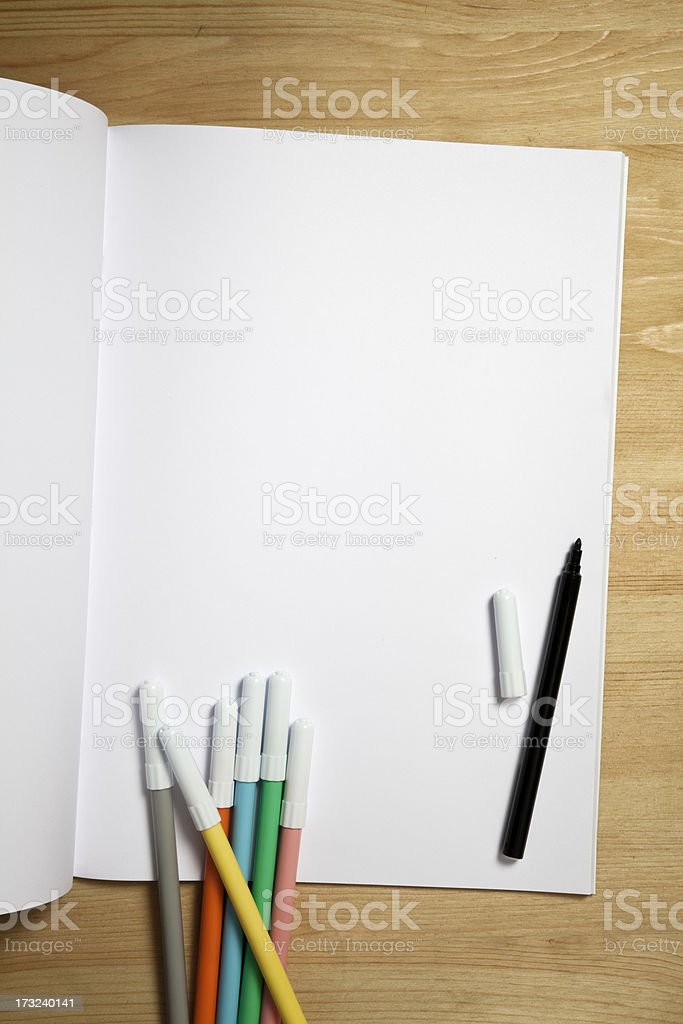 White paper notebook with color pens stock photo