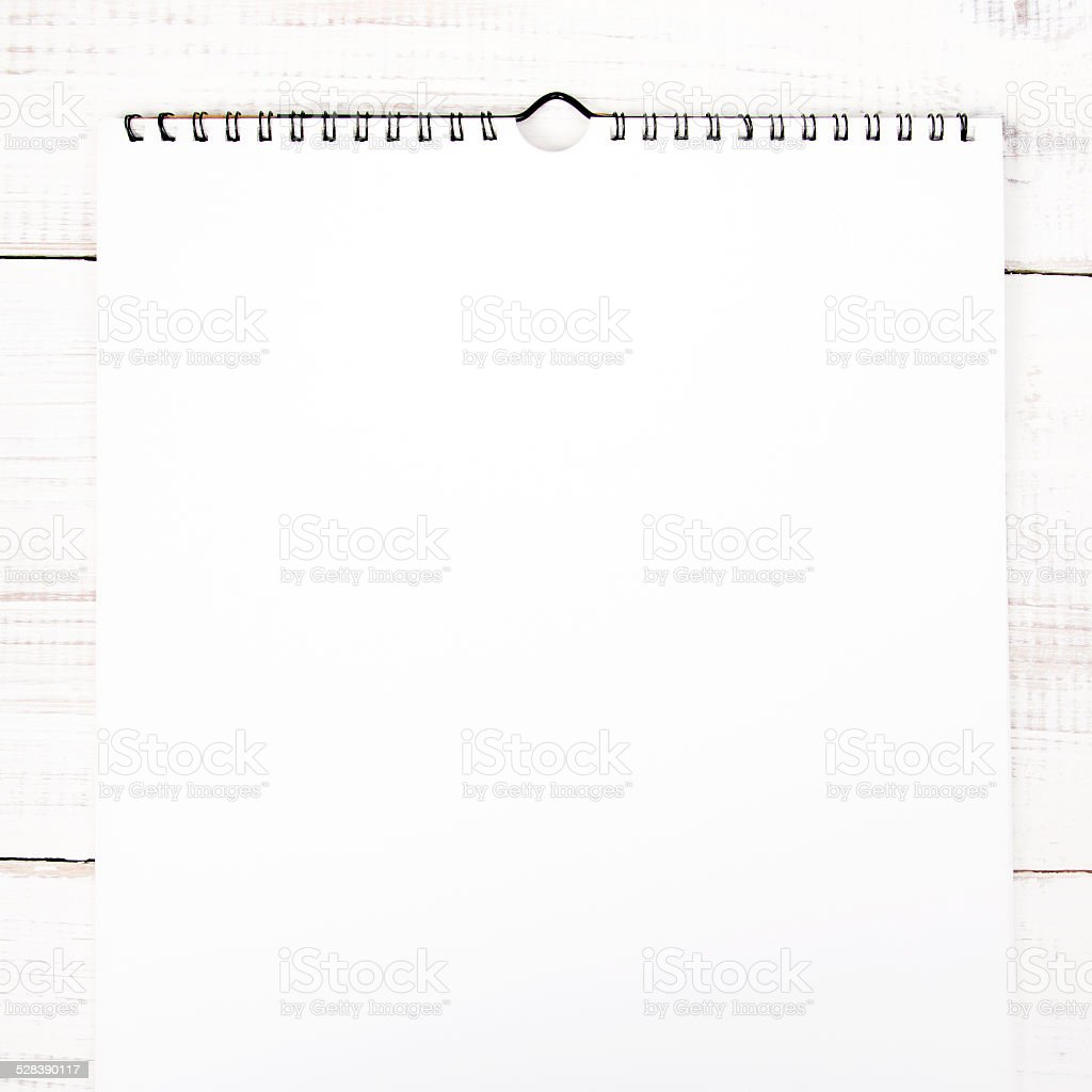 white paper (blank calendar) on a white wooden background stock photo