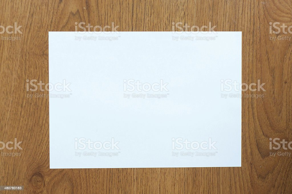 White paper on table wood stock photo
