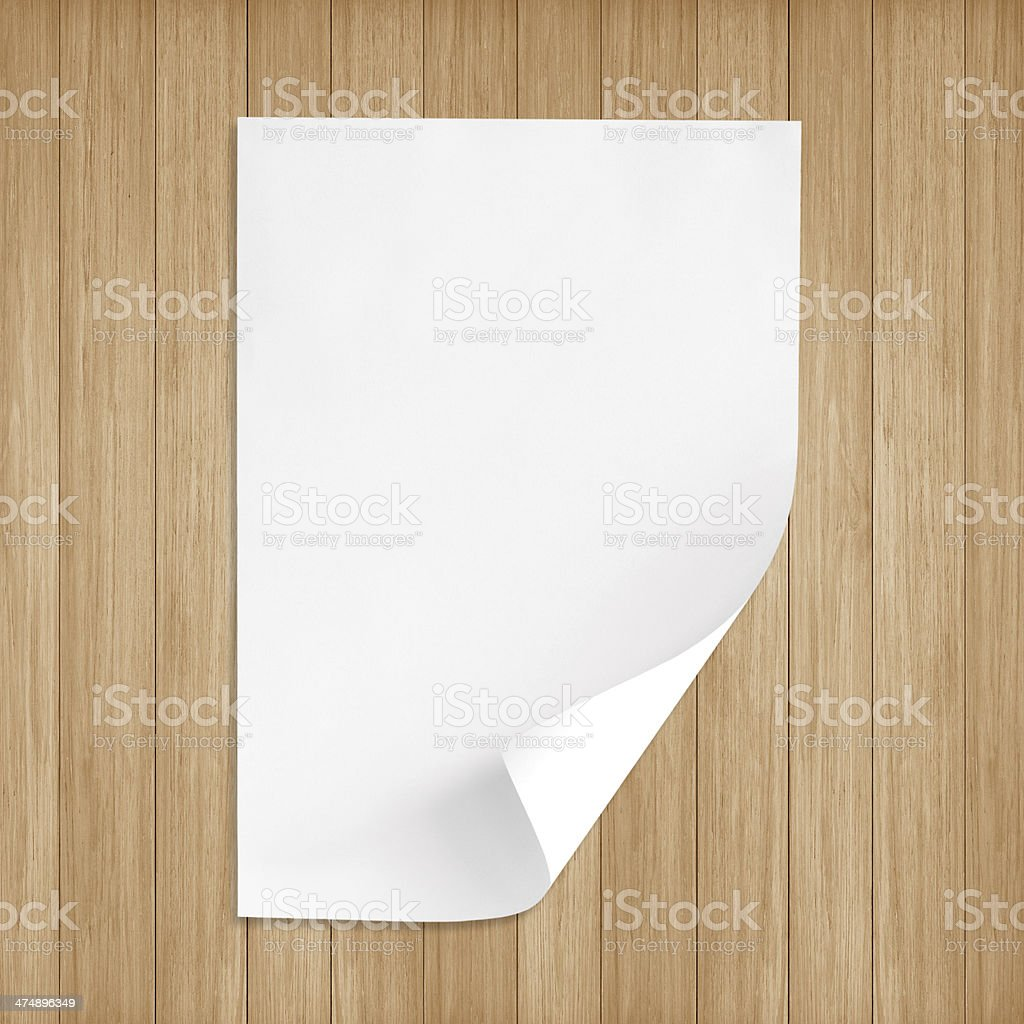 White paper on wood floor royalty-free stock photo