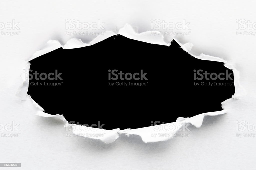 White paper ripped to create a black hole stock photo