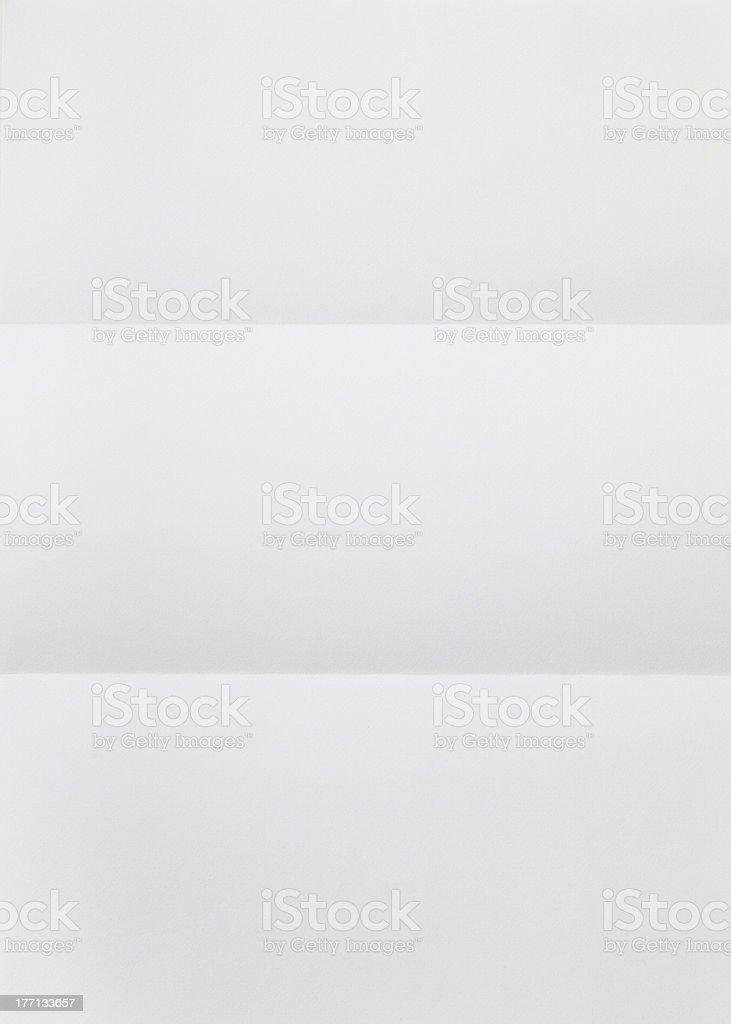 White paper sheet folded of tree stock photo