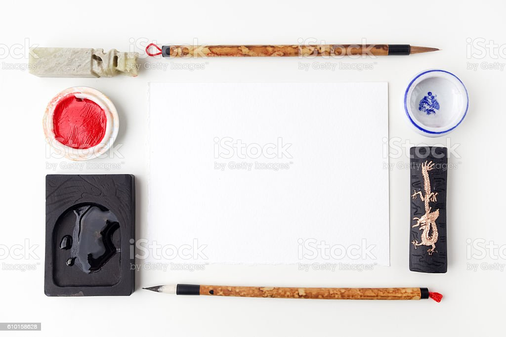 white paper sheet mockup with calligraphy tools. Flat lay. Top stock photo