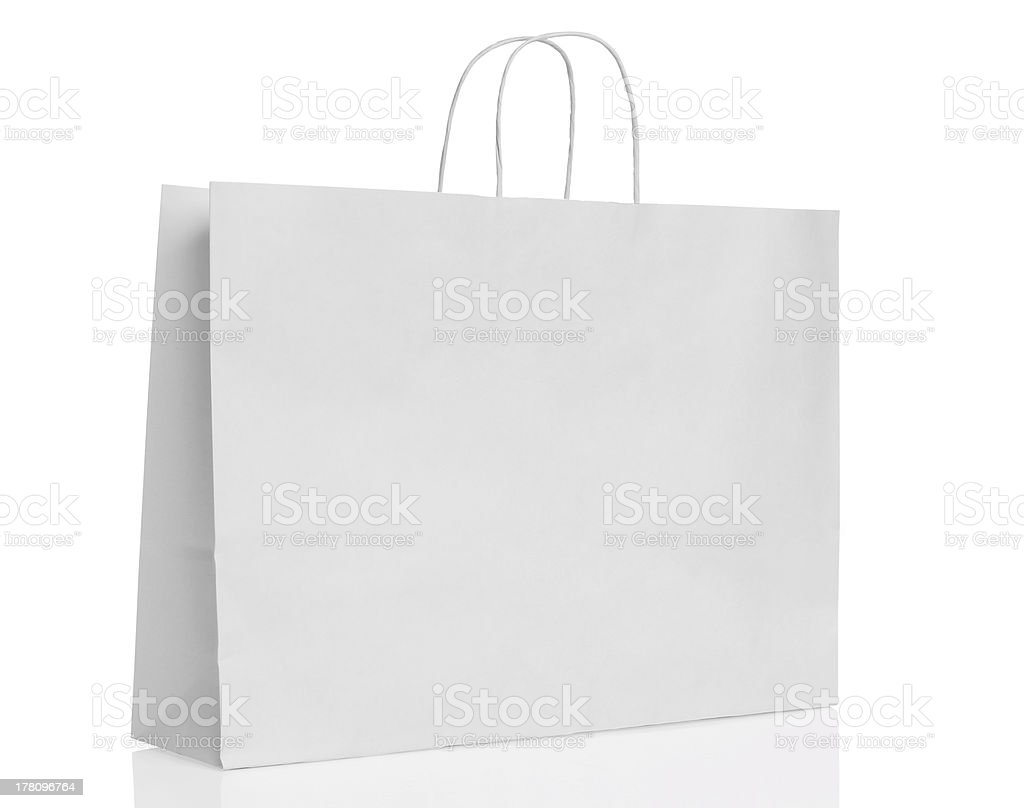 White paper shopping bag isolated with reflection stock photo