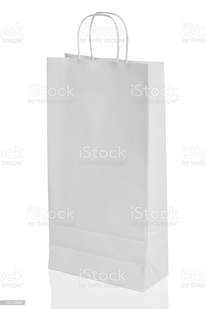 White paper shopping bag isolated with reflection royalty-free stock photo