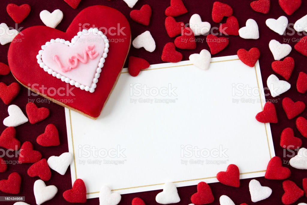 White paper surrounded by red and white hearts stock photo