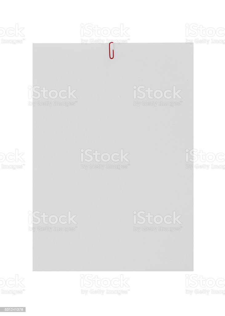 white paper with paperclip. stock photo