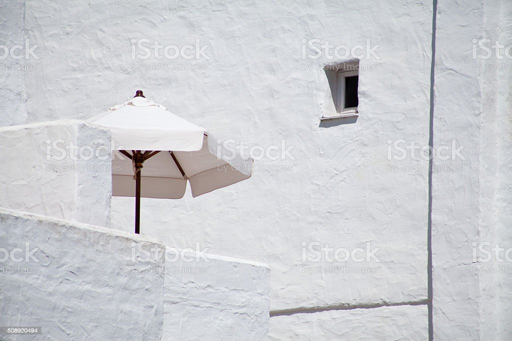 White parasol  +  shade in white spanish andalucia architecture stock photo