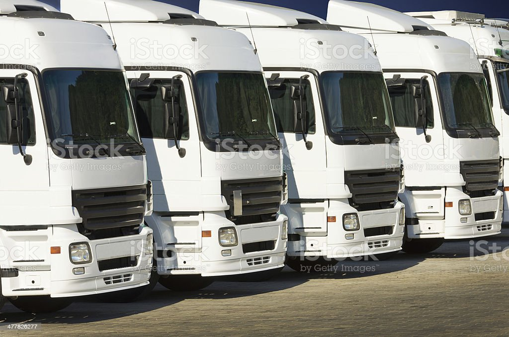 white parked trucks royalty-free stock photo
