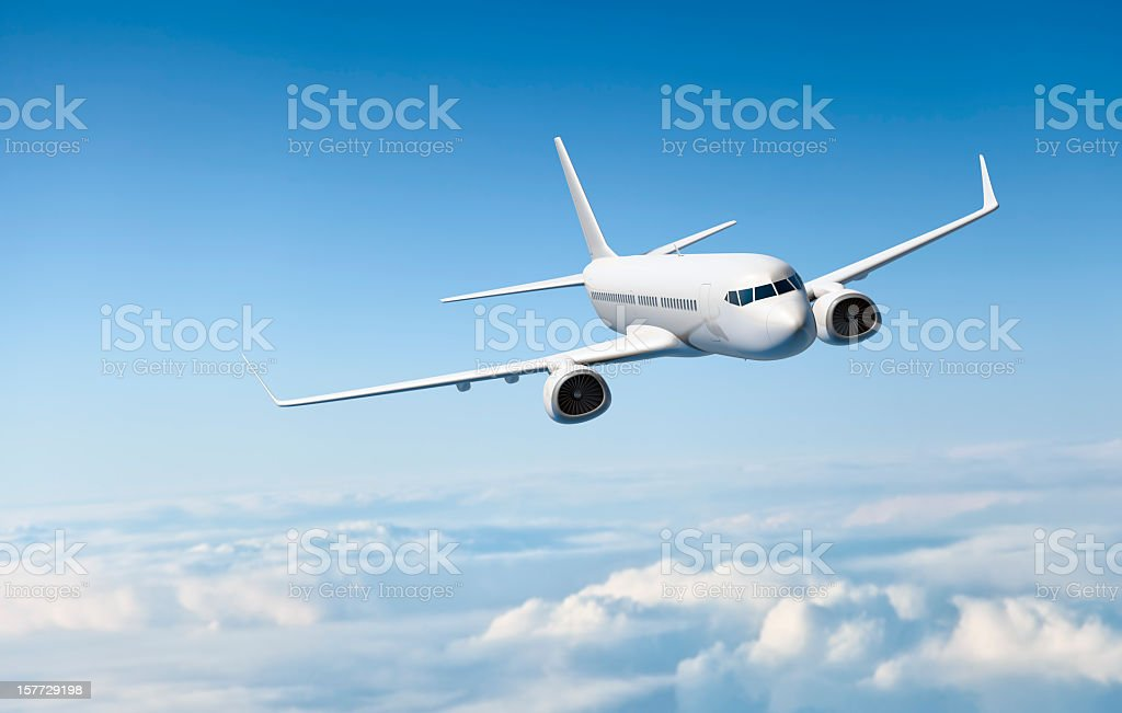 White passenger aircraft flying over clouds stock photo
