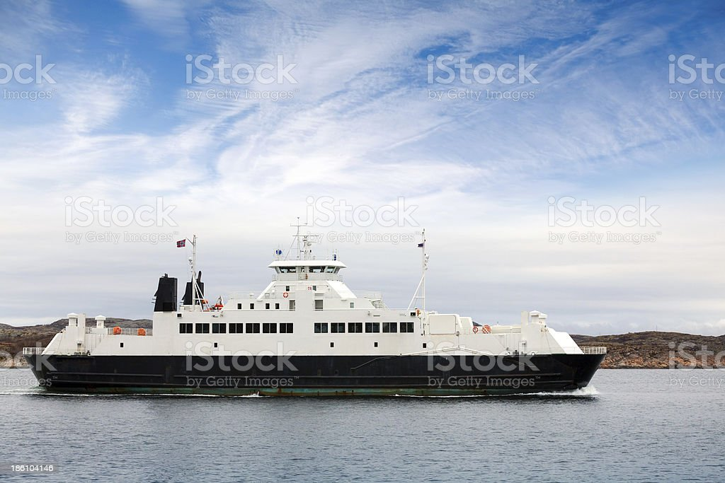 White passenger ferry goes on fjord in Norway royalty-free stock photo