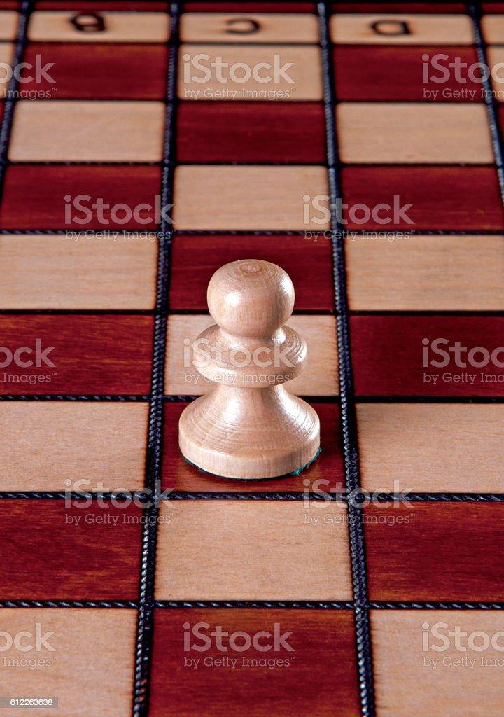 White pawn chess piece stock photo