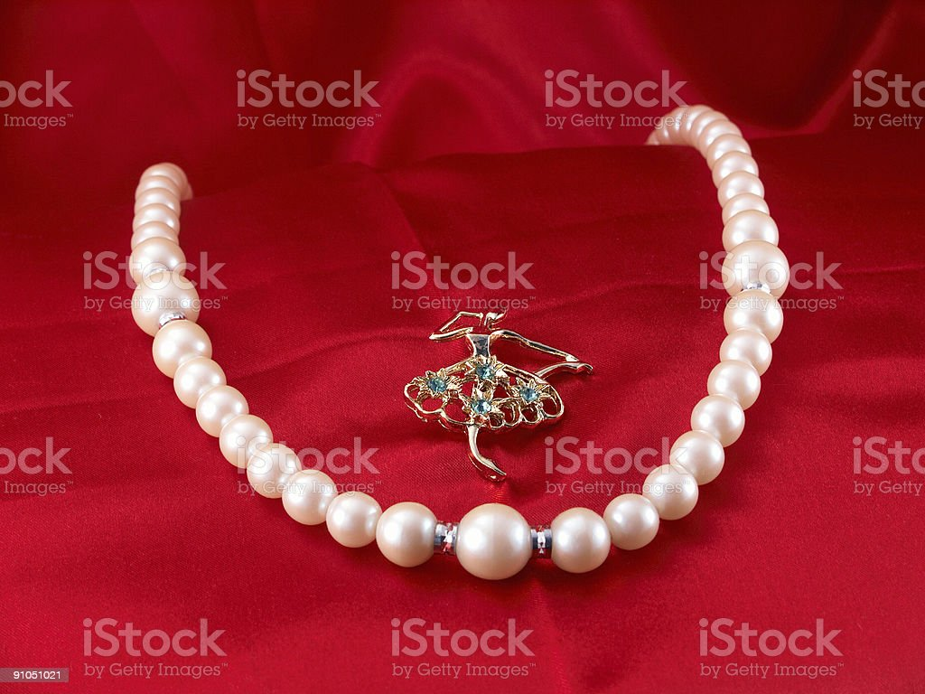 White pearl choker and dancer pin royalty-free stock photo