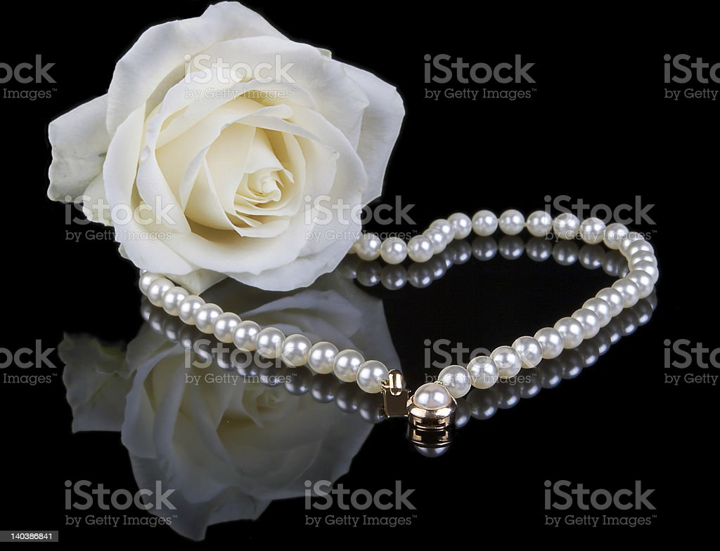 White pearls and rose royalty-free stock photo